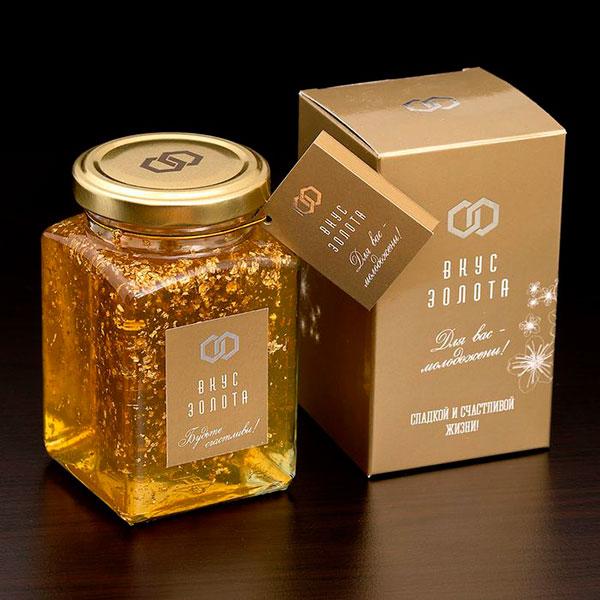Банка меда с частицами золота